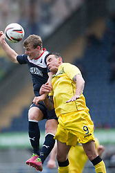 Falkirk's Stephen Kingsley and Queen of the South's Derek Lyle.<br /> Half time : Falkirk 0 v 0 Queen of the South, Scottish Championship game today at the Falkirk Stadium.<br /> &copy; Michael Schofield.