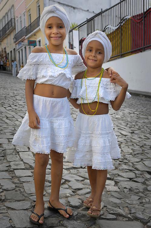 Two girls in local dress, Salvador de Bahia, Northeast, Brazil, South America