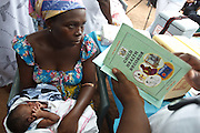 Ghana: 25 April 2012, A woman waits for her daughter to be vaccinated while a nurse checks her health record at the Dodowa new town health outreach point in Dodowa.The GAVI Alliance is a public-private partnership that brings together developing country and donor governments, WHO, UNICEF, the World Bank, the vaccine industry in both industrialised and developing countries, research and technical agencies, civil society, the Bill & Melinda Gates Foundation and other private philanthropists.  Set up in 2000 as the Global Alliance for Vaccines and Immunisation, GAVI's mission is to save children's lives and protect people's health by increasing access to immunisation in the world's poorest countries.