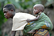 Tribal Pygmy dancing with baby near Bwindi National Park. Uganda, Africa.