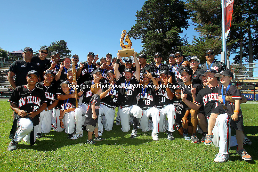 Black Sox's Captain Rhys Casley leads the celebration with the team holding up the trophy. 2013 ISF Mens World Softball Championship, Gold Medal Game, New Zealand Black Sox v Venezuela, Rosedale Park, Albany, New Zealand. Sunday 10th March 2013. Photo: Anthony Au-Yeung / photosport.co.nz