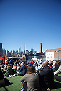QUEENS, NY - April 8, 2017: Visitors at the LIC Flea overlooking the Manhattan Skyline.<br /> <br /> Credit: Clay Williams for 111 Places in Queens You Must Not Miss.<br /> <br /> © Clay Williams / http://claywilliamsphoto.com