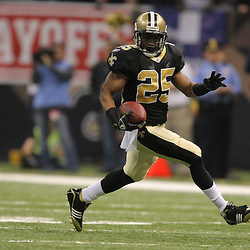 Jan 24, 2010; New Orleans, LA, USA; New Orleans Saints running back Reggie Bush (25) runs with the ball against the Minnesota Vikings during the second quarter of the 2010 NFC Championship game at the Louisiana Superdome. Mandatory Credit: Derick E. Hingle-US PRESSWIRE