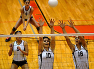 1 Nov. 2011 -- EDWARDSVILLE, Ill. -- Belleville West High School girls' volleyball players Sara Stevenson (10) and Emily Becker (19) leap to block a spike attempt by Edwardville High School during the IHSA Class 4A girls volleyball sectional semifinal at Edwardsville High School in Edwardsville, Ill. Tuesday, Nov. 1, 2011. Photo © copyright 2011 Sid Hastings.