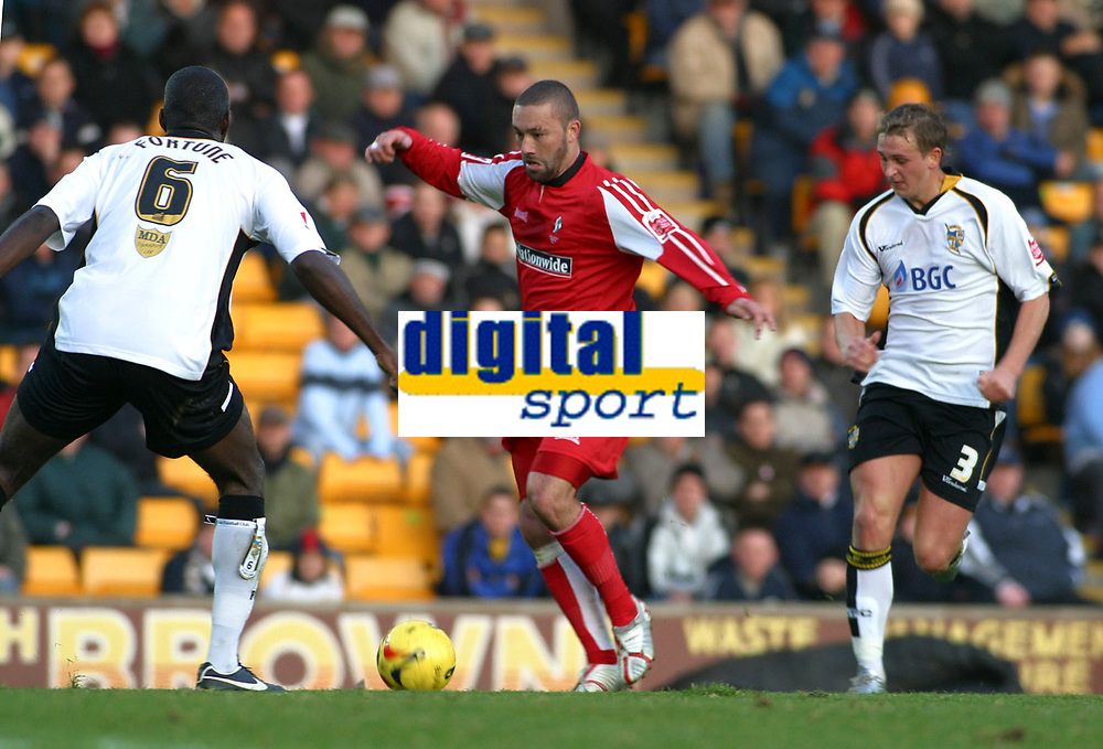 Photo: Dave Linney.<br />Port Vale v Swindon Town. Coca Cola League 1.<br />19/11/2005. Christin Roberts(Swindon) on the attack with the close attention of Clayton Fortune(Vale) &Craig James(Vale/Right)