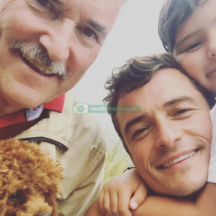 "Orlando Bloom releases a photo on Instagram with the following caption: ""3 generations and a mighty right there\ud83d\ude4f\ud83c\udffb\ud83d\ude4c\ud83c\udffb\ud83d\udc4a\ud83c\udffb"". Photo Credit: Instagram *** No USA Distribution *** For Editorial Use Only *** Not to be Published in Books or Photo Books ***  Please note: Fees charged by the agency are for the agency's services only, and do not, nor are they intended to, convey to the user any ownership of Copyright or License in the material. The agency does not claim any ownership including but not limited to Copyright or License in the attached material. By publishing this material you expressly agree to indemnify and to hold the agency and its directors, shareholders and employees harmless from any loss, claims, damages, demands, expenses (including legal fees), or any causes of action or allegation against the agency arising out of or connected in any way with publication of the material."