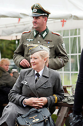 reenactors dressed as German army female signals auxiluaries (Nachrichtenheflrennin des heeres) also nicknamed Blitzmädchen or lightening girls because of the signals insignia on their uniforms, at Northallerton Wartime Weekend is a fund raising event that happens throughout the Yorkshire market town of Northallerton. .With help of volunteers and local business it has been successful in raising money for the charities.Help for Heroes.Royal British Legion.Bomber Command Memorial Charity .Ben Hyde Memorial Fund.<br /> 16/17 June 2012<br /> Image © Paul David Drabble