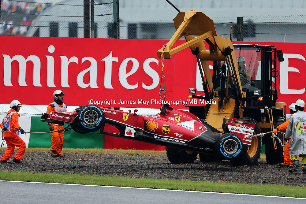 Marshals recover the Ferrari F14-T of race retiree Fernando Alonso (ESP) Ferrari with a digger.<br /> Japanese Grand Prix, Sunday 5th October 2014. Suzuka, Japan.