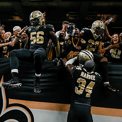 Sep 16, 2018; New Orleans, LA, USA; New Orleans Saints cornerback Marshon Lattimore (23) and linebacker Demario Davis (56) and  cornerback Justin Hardee (34) celebrate with fans in the stands after a missed field goal by Cleveland Browns place kicker Zane Gonzalez (not pictured) during the fourth quarter of a game at the Mercedes-Benz Superdome. The Saints defeated the Browns 21-18. Mandatory Credit: Derick E. Hingle-USA TODAY Sports