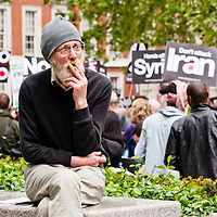LONDON, UK - 19 May 2012: participants at the Say No To NATO protest called by STWC and CND in front of the US embassy in Grosvenor Square. The protest is held one day before the NATO summit in Chicago to discuss the alliance's global military reach.