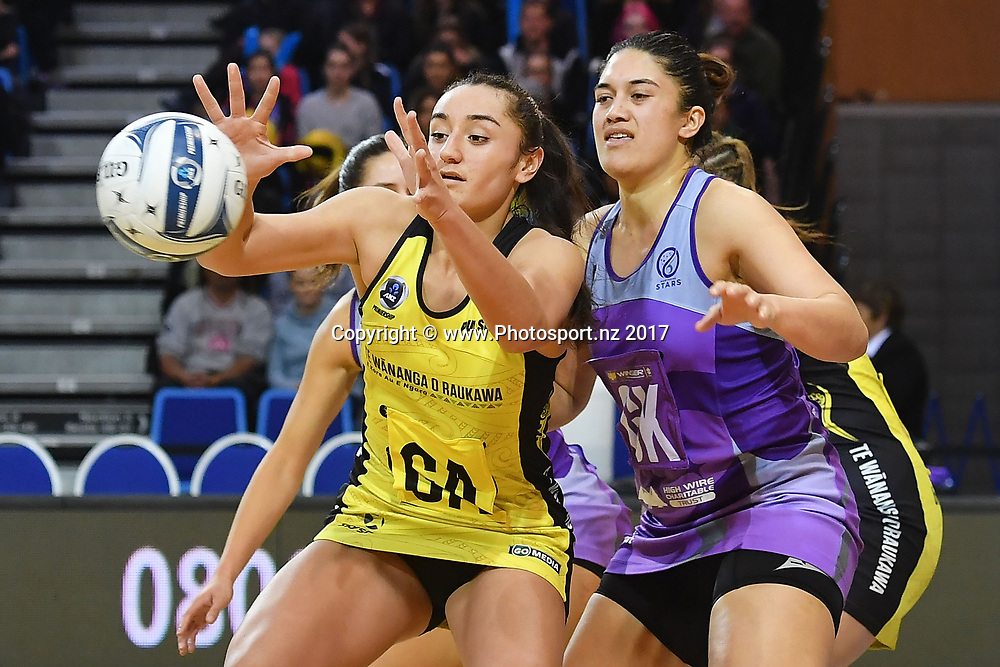 Pulse's Tiana Metuarau (L) takes a pass during the ANZ Premiership netball match between the Pulse and Northern Stars at the Te Rauparaha Arena on Wednesday the 14th of June 2017. Copyright Photo by Marty Melville / www.Photosport.nz