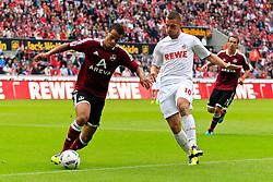 11.09.2011,  Rhein Energie Stadion, Koeln, GER, 1.FBL, 1. FC Koeln vs 1. FC Nürnberg, im Bild.Timothy Chandler (Nuernberg #26) (L) gegen Lukas Podolski (Koeln #10)..// during the 1.FBL, 1. FC Koeln vs 1. FC Nürnberg on 2011/09/11, Rhein-Energie Stadion, Köln, Germany. EXPA Pictures © 2011, PhotoCredit: EXPA/ nph/  Mueller *** Local Caption ***       ****** out of GER / CRO  / BEL ******