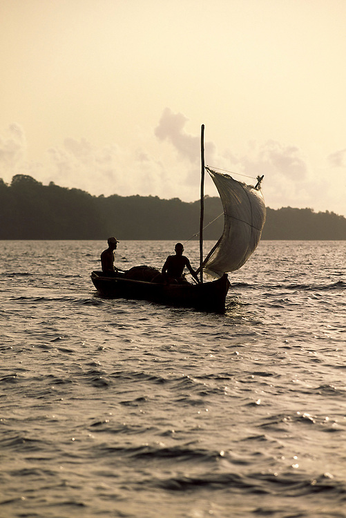 Fishermen from Principe island sailing in a traditional boat.