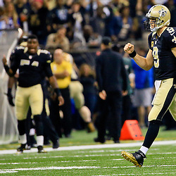 Nov 1, 2015; New Orleans, LA, USA; New Orleans Saints quarterback Drew Brees (9) celebrates after throwing a touchdown against the New York Giants during the first quarter of a game at the Mercedes-Benz Superdome. Mandatory Credit: Derick E. Hingle-USA TODAY Sports