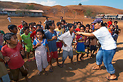 Hesti Widido works a crowd of school kids, Papagaran island, Komodo National Park