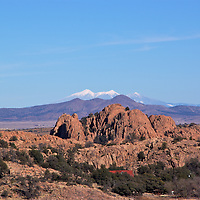 Three Peaks leads to the San Francisco Peaks by Flagstaff. This shot taken in Prescott, Arizona. The Dells are in the foreground.
