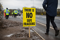 © Licensed to London News Pictures . 10/03/2017 . Preston , UK . Anti fracking signs and protesters along the roadside opposite the entrance to the fracking site on Plumpton Hall Farm . Farmer Allan Wendlsy faces protests from neighbours and environmental campaigners after renting fields around his farm , Plumpton Hall Farm , to fracking firm Cuadrilla . Photo credit : Joel Goodman/LNP
