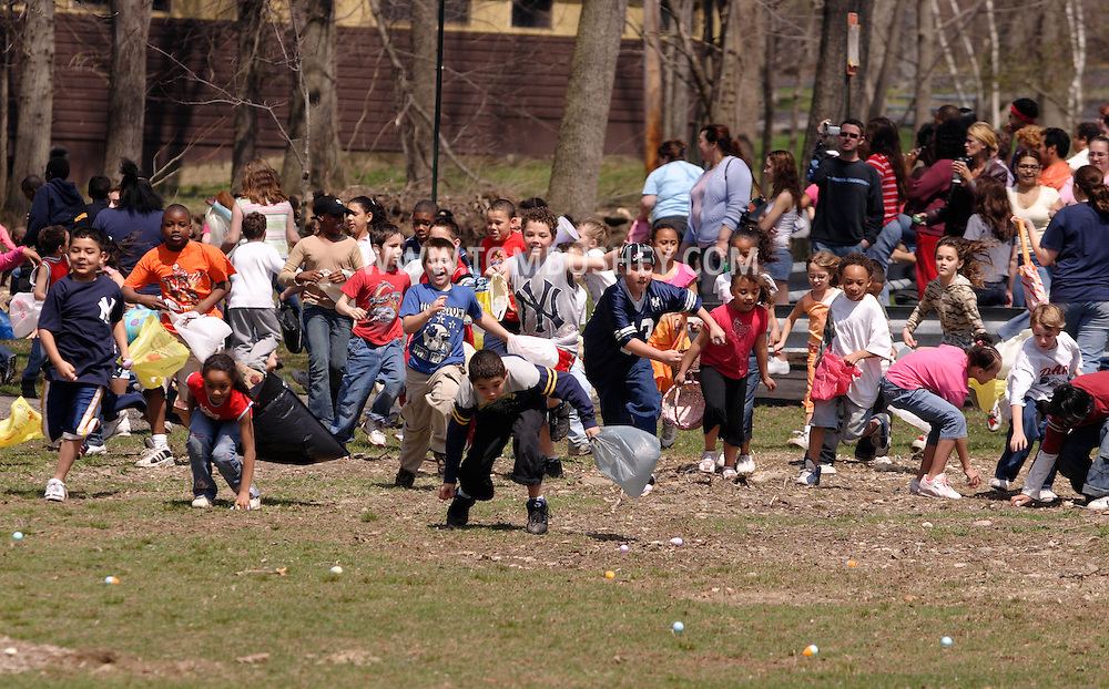 Middletown, N.Y. - Children run with their bags at the start of an Easter egg hunt at Fancher-Davidge Park on April 15, 2006.