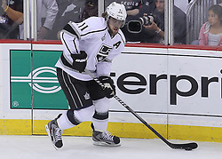 June 9, 2012; Newark, NJ, USA;  Los Angeles Kings center Anze Kopitar (11) skates with the puck during the first period of Game 5 of the 2012 Stanley Cup Finals at the Prudential Center.