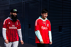 LIVERPOOL, ENGLAND - Saturday, March 23, 2019: Two supporters, one wearing an AC Milan short and one wearing a Liverpool shirt outside Anfield before the LFC Foundation charity match between Liverpool FC Legends and Milan Glorie at Anfield. (Pic by Paul Greenwood/Propaganda)