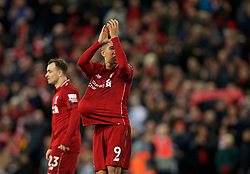 LIVERPOOL, ENGLAND - Saturday, December 29, 2018: Liverpool's hat-trick Roberto Firmino walks off with the match ball after the FA Premier League match between Liverpool FC and Arsenal FC at Anfield. Liverpool won 5-1. (Pic by David Rawcliffe/Propaganda)