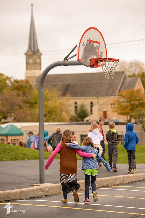 Friends walk together to the playground on Thursday, Oct. 27, 2016, at First Immanuel Lutheran School in Cedarburg, Wis. In the distance was the original sanctuary for First Immanuel. LCMS Communications/Erik M. Lunsford
