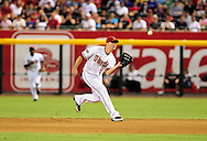 Jul. 15 2011; Phoenix, AZ, USA; Arizona Diamondbacks infielder Kelly Johnson (2) catches a pop fly during the fifth inning against the Los Angeles Dodgers at Chase Field. Mandatory Credit: Jennifer Stewart-US PRESSWIRE