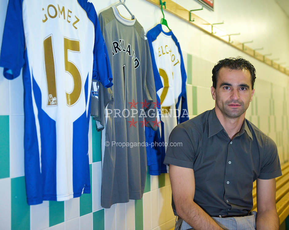 WIGAN, ENGLAND - Monday, August 24, 2009: Wigan Athletic's manager Roberto Martinez in the team dressing room at the JJB Stadium. (Photo by David Rawcliffe/Propaganda)