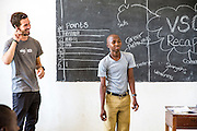 ICS volunteer Joe Radcliffe assisting a student with a mid class activity of positive English phrases charades at Mingoyo school as part of the VSO / ICS Elimu Fursa project (Opportunities in Education) Lindi, Lindi region. Tanzania.