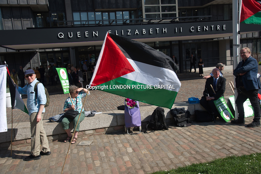 Activists and supporters of Palestian protest against HSBC complicity of Israel War crime demand HSBC Stop Arming Israel During HSBC annual meeting at the front of the QEII Centre. on 20 April 2018, London, UK.