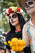 A young woman dressed in La Calavera Catrina costume during the Day of the Dead or Día de Muertos festival October 31, 2017 in Patzcuaro, Michoacan, Mexico. The festival has been celebrated since the Aztec empire celebrates ancestors and deceased loved ones.