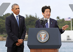 "US-Präsident Barack Obama und Japans Premier Shinzo Abe beim Gedenken an die Opfer des japanischen Angriffs auf Pearl Harbor vor 75 Jahren / 271216<br /> <br /> <br /> <br /> ***Japanese Prime Minister Shinzo Abe (R) gives a speech, along with U.S. President Barack Obama, at Pearl Harbor in Hawaii on Dec. 27, 2016, offering his ""sincere and everlasting condolences"" for those who died in the Japanese attack there in 1941.***"