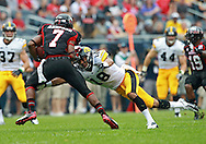September 01 2012: Iowa Hawkeyes cornerback Micah Hyde (18) dives for Northern Illinois Huskies wide receiver Perez Ashford (7) during the first half of the NCAA football game between the Iowa Hawkeyes and the Northern Illinois Huskies at Soldiers Field in Chicago, Illinois on Saturday September 1, 2012. Iowa defeated Northern Illinois 18-17.