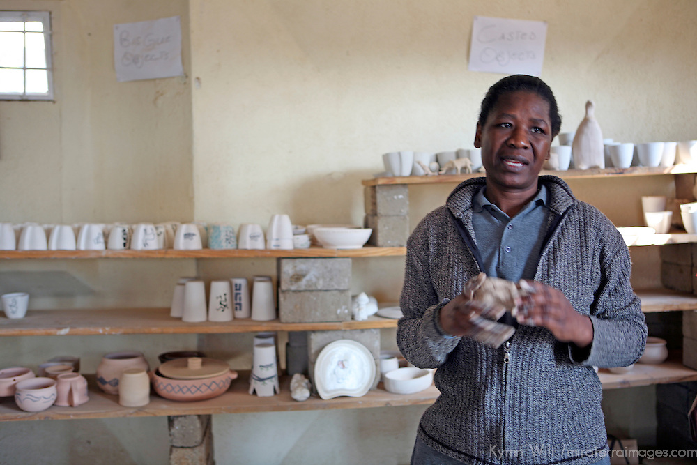 Africa, Namibia, Windhoek. Namibian woman at Penduka development cooperation organization explains process of creating pottery from recylced materials.