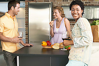Friends preparing dinner together portrait
