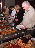 (from left) Weigie Pomianowski of Beavercreek, Nancy Dean, Karen Dean and Karl Dean as Riverside Area Chamber of Commerce hosts an International Night featuring Indian and American food at the Filling Station Sports Bar & Grill in Riverside, Monday, March 26, 2012.  Owner Doctor Suresh Gupta prepared Indian cuisine including Bean Sprout Cucumber Salad, Butter Chicken, Samosas, Rice/Naan Bread and Veggie Khorma.