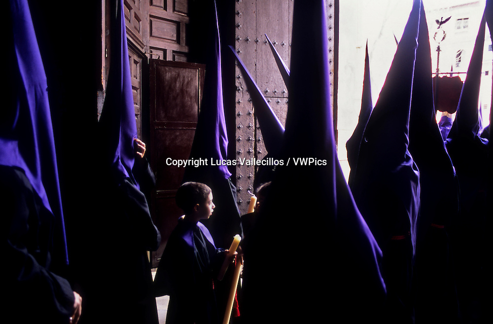 Penitents. Good Friday.In Santo domingo church. Brotherhood of `Soledad Campo Principe´. Granada. Andalusia, Spain