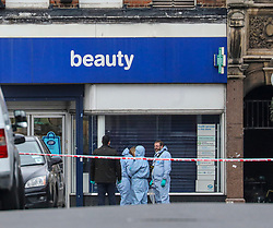 © Licensed to London News Pictures. 03/02/2020. London, UK. Forensic officers on Streatham High Road outside Boots Chemists where a knife-wielding terror suspect in a suicide vest was shot dead after stabbing two people. Photo credit: Alex Lentati/LNP