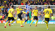 Sheffield Wednesday's Atdhe Nuhiu battles for the ball against Watford Ben Watson during the Sky Bet Championship match between Watford and Sheffield Wednesday at Vicarage Road, Watford, England on 2 May 2015. Photo by Phil Duncan.