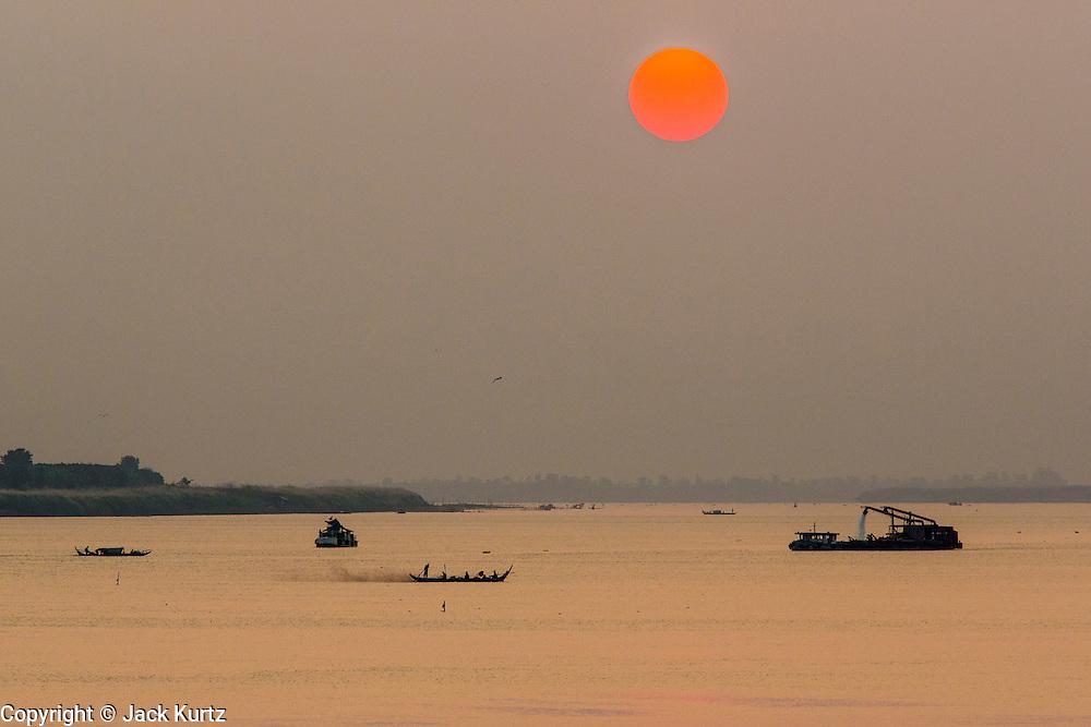 01 FEBRUARY 2013 - PHNOM PENH, CAMBODIA:  Sunrise on the Mekong River in Phnom Penh, Cambodia.     PHOTO BY JACK KURTZ