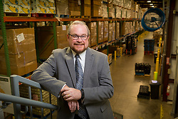 Mike Halligan CEO of God's Pantry poses for portraits, Thursday, April 13, 2017 at God's Pantry Food Bank in Lexington.