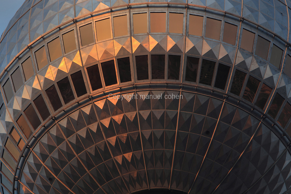 Sunset reflecting off the dome of the Fernsehturm or Television Tower, built 1965-69 on Alexanderplatz in the former East Berlin, Germany. The tower is 368m tall and the tallest structure in Germany. Picture by Manuel Cohen