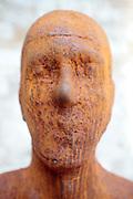 close up of face made from corten steel by the Icelandic artist Steinunn Thórarinsdóttir