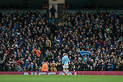 Kelechi Iheanacho (Manchester City) and Pablo Zabaleta (Manchester City) celebrate scoring the equaliser in front of the fans during the Barclays Premier League match between Manchester City and Tottenham Hotspur at the Etihad Stadium, Manchester, England on 14 February 2016. Photo by Mark P Doherty.