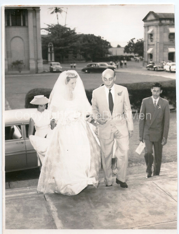 """Uncle Hildon and Jean entering the church"". 1958..Michael Mack on right in a suit. On the back of this print is a rubber stamp with the name Felsinger, photographer, Peradeniya Road, Kandy."