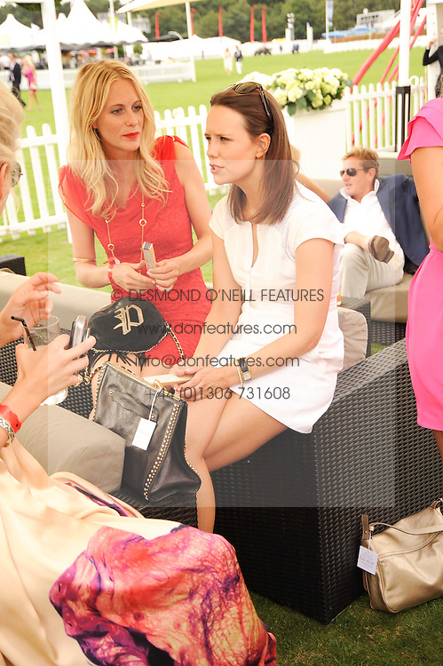 Left to right, POPPY DELEVINGNE and ARABELLA MUSGRAVE at the Cartier International Polo at Guards Polo Club, Windsor Great Park, Berkshire on 25th July 2010.