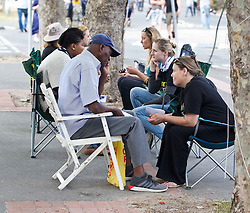 Counsellors give a sympathetic ear at the Sidewalk Talk station on King Langalibalele Street during the Open Streets Langa event on 30 October 2016, when the street was closed to motorised vehicles and opened to people. Hosted by Open Streets Cape Town and supported by the City of Cape town and WWF. photo by John Tee/RealTime Images.
