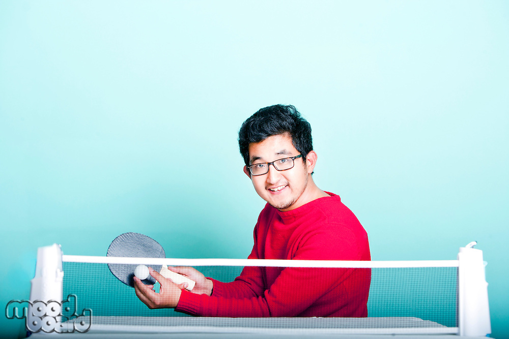 Asian man playing table tennis