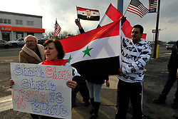 3/28/2013 Whitehall, PA Syrian-American protestors converged on the corner of Grape Street and MacArthur Road in Whitehall Friday evening in protest of the closure of the Syrian Consulate in Washington, DC.  Photo | CHRIS POST
