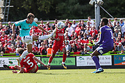 Forest Green Rovers Christian Doidge(9) lobs Swindon Town goalkeeper Lawrence Vigouroux(1) during the EFL Sky Bet League 2 match between Forest Green Rovers and Swindon Town at the New Lawn, Forest Green, United Kingdom on 25 August 2018.